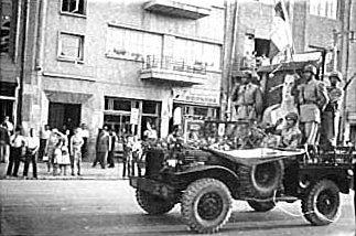 The coup d'état makers (the Shah's troops) carrying the portrait of the Shah, August 19, 1953